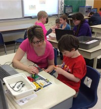 Students and Staff using coding and robotics tools
